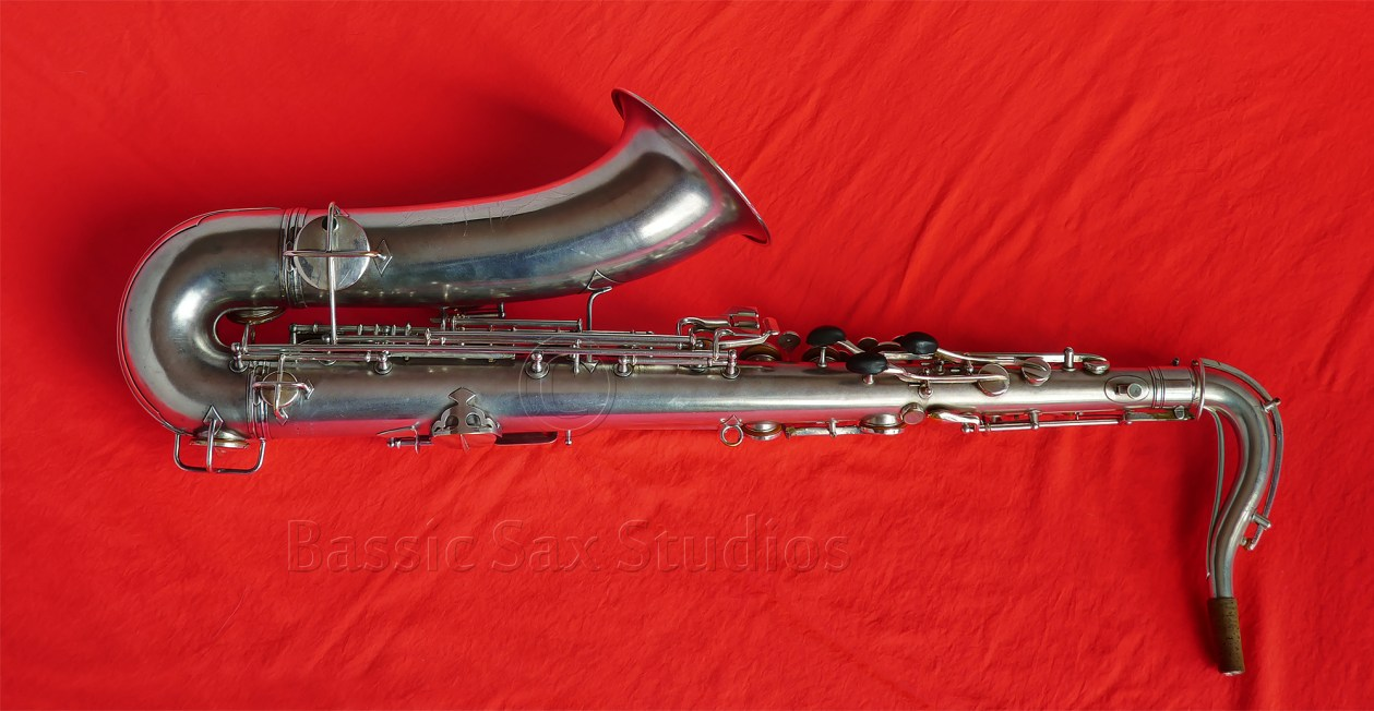 Conn New Wonder Series I tenor sax, silver sax, red background, vintage sax