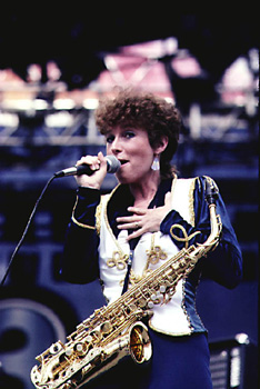 Rindy Ross, female musician, alto saxophone, rock 'n roll, microphone
