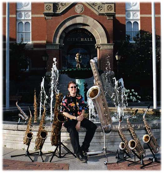city hall, Fredericton, NB, fountain, saxophones, female saxophone player, bass saxophone, soprano sax, alto sax, tenor sax, baritone sax, C melody sax