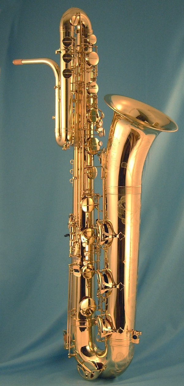 Selmer, bass saxophone, Series II, gold lacquer, blue background