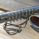 Czech tin sax, blow accordion, vintage toy musical instrument