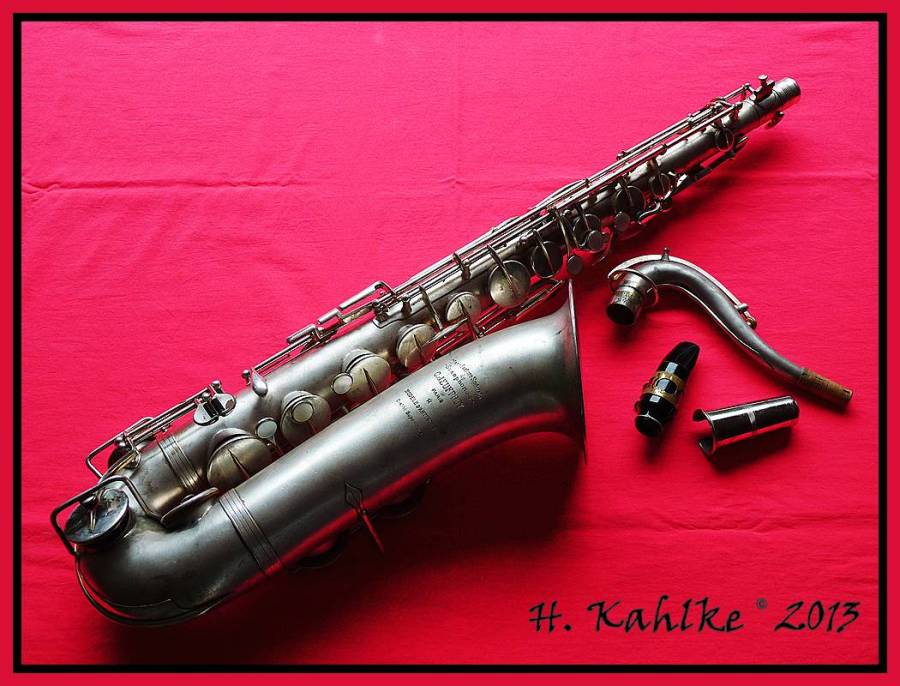 Pierret tenor saxophone, tenor sax, French vintage sax, silver sax, red cloth bacground, HDR photography