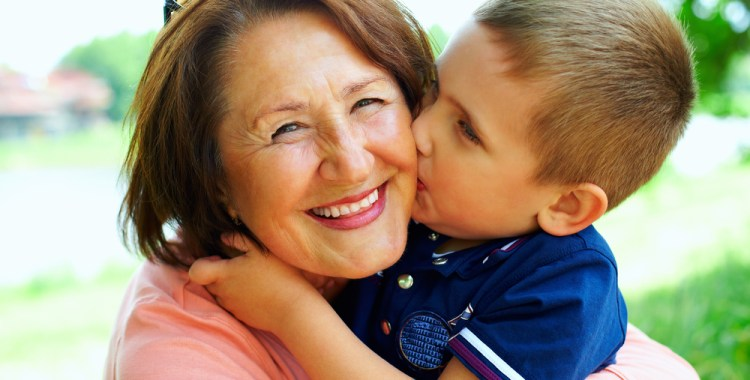 happy grandma with grandson embracing outdoor