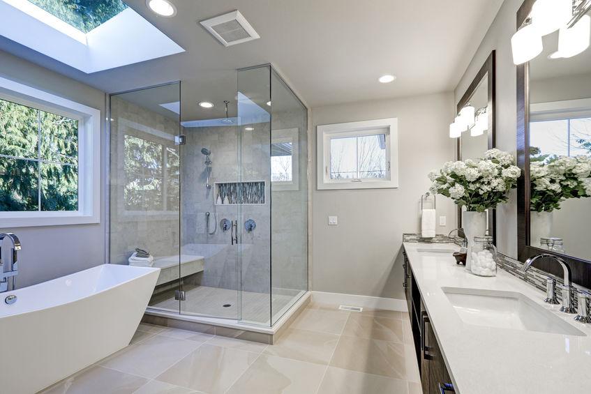 Spacious bathroom in gray tones with heated floors