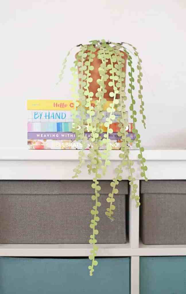 An image of a paper string of pearls plant for your garden party.