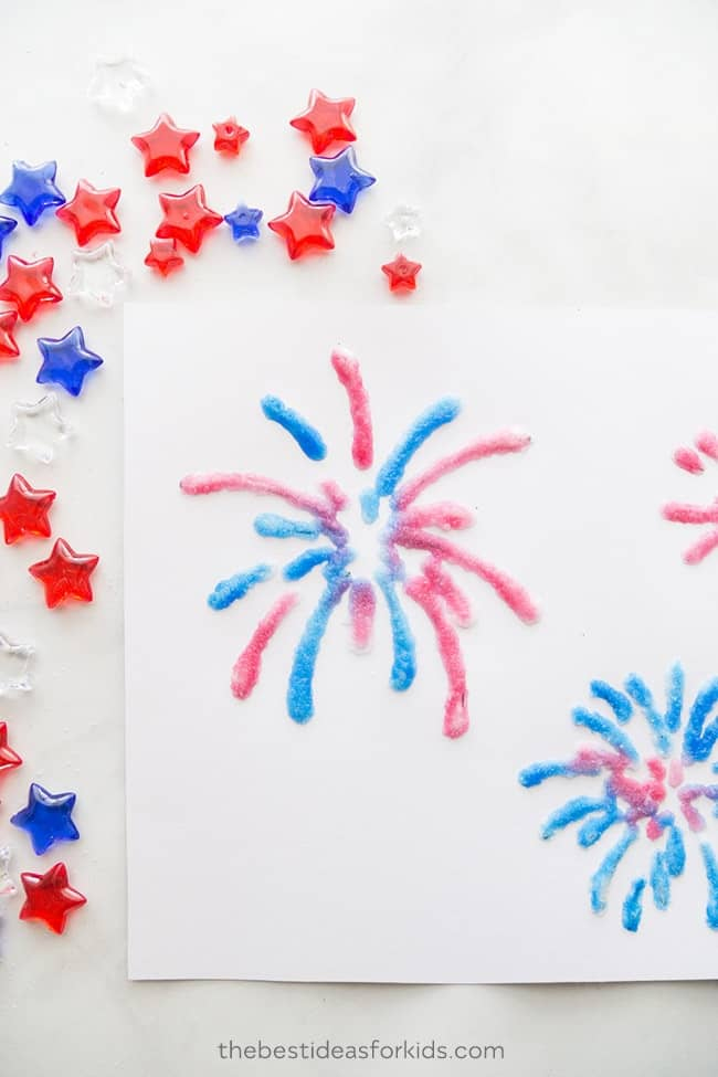 Red and Blue painted fireworks painted with water color paint, glue and salt.