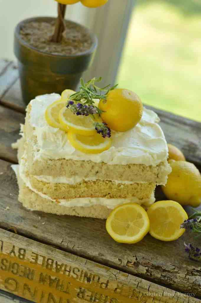 Lemon cake with creamy frosting and a lavender sprig on top