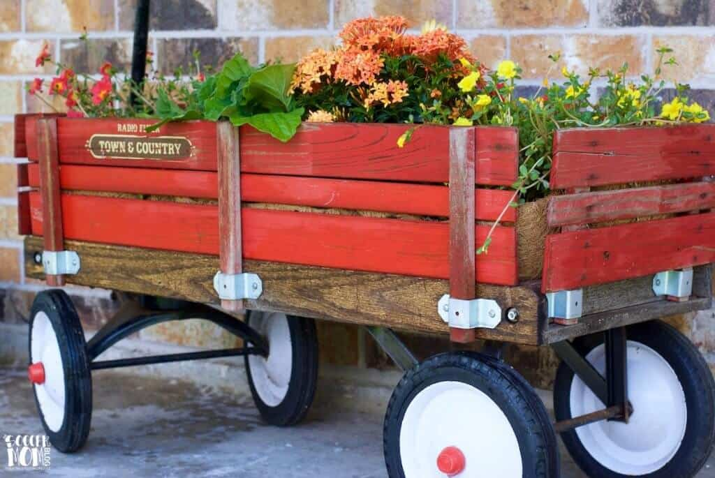 Make a planter out of a vintage wooden wagon.
