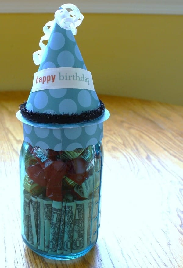 Add money and candy to a mason jar for a fun gift.