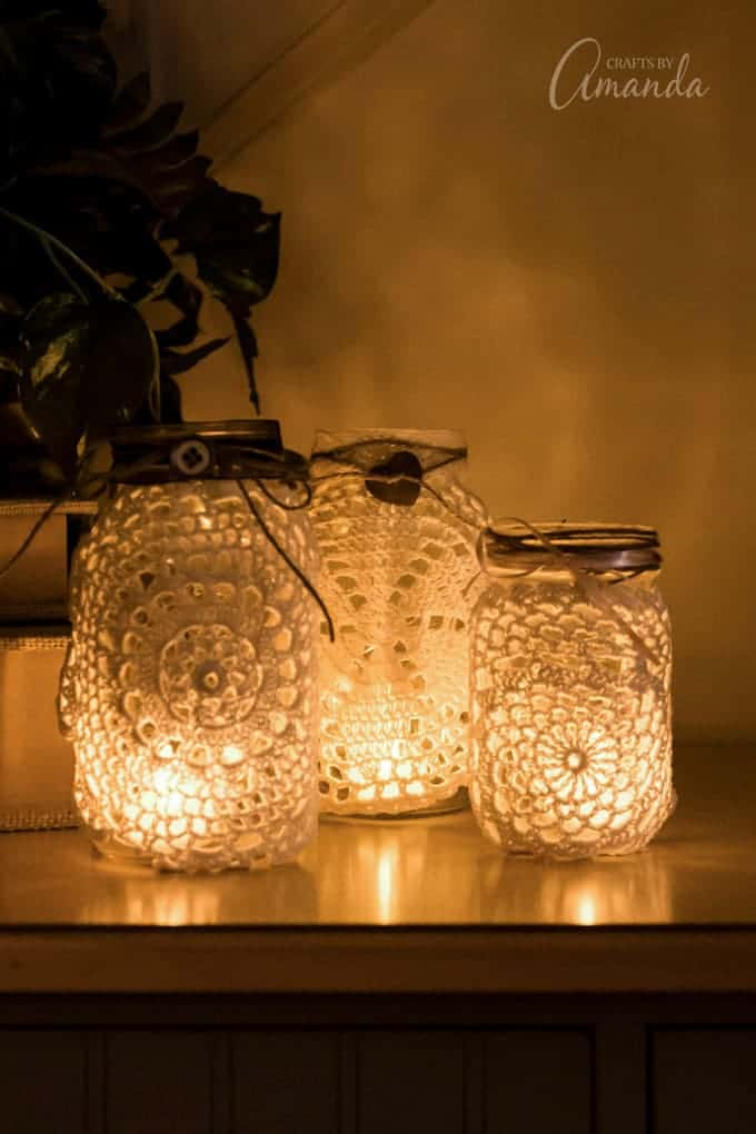 A mason jar light made with a burlap doily.
