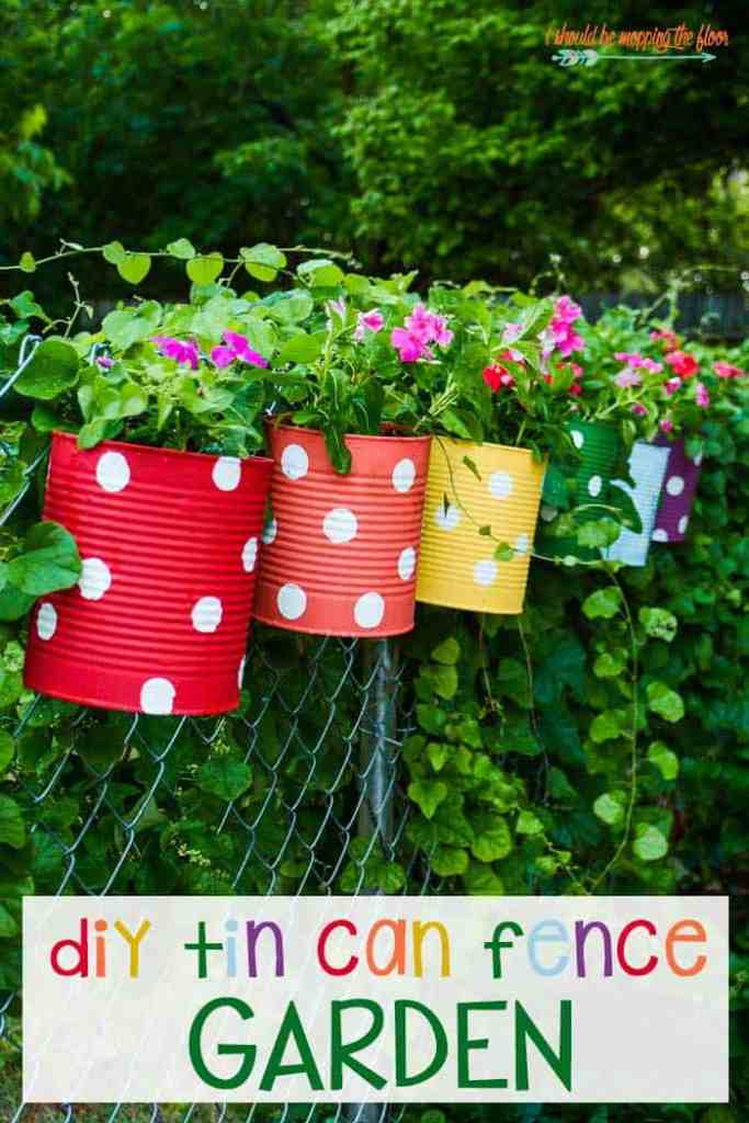 Create a colorful tin can garden fence planter with spray paint and old tin cans,