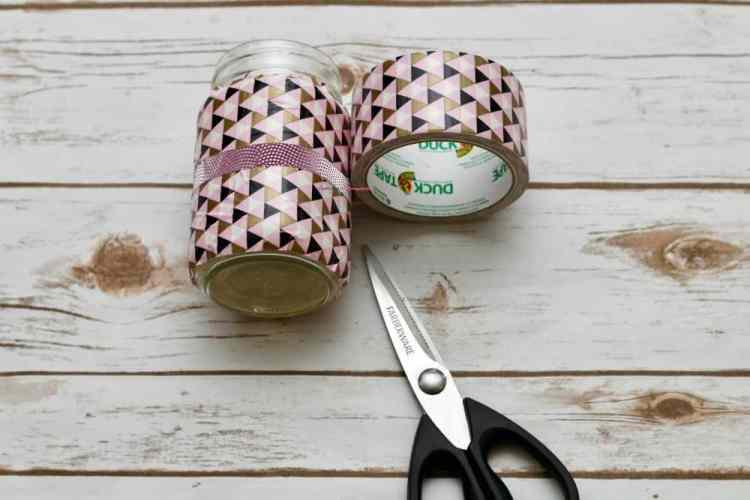 A mason jar covered in duck tape.