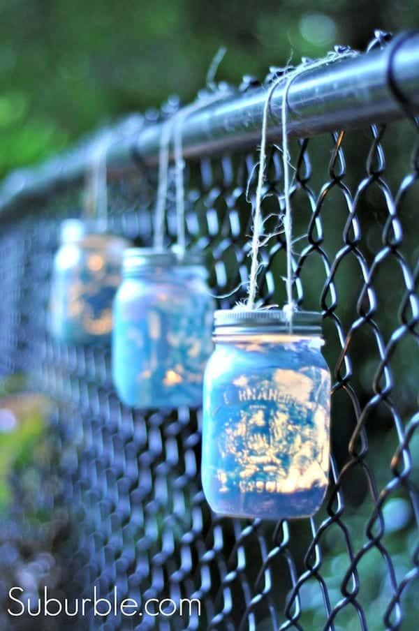 Paint some mason jars, add lights and hang them for some neat backyard lighting.