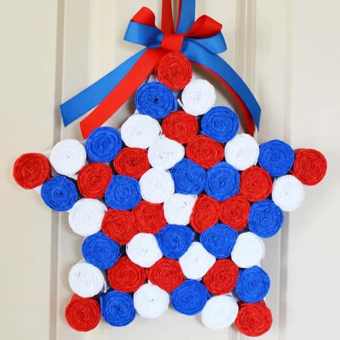 Red white and blue crepe paper rolls in the shape of a star