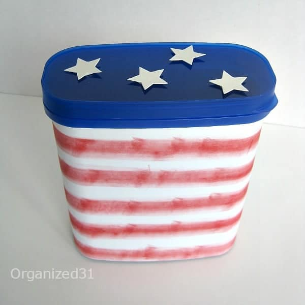 A re-purposed canister with a blue star lid and red and white striped bottom.