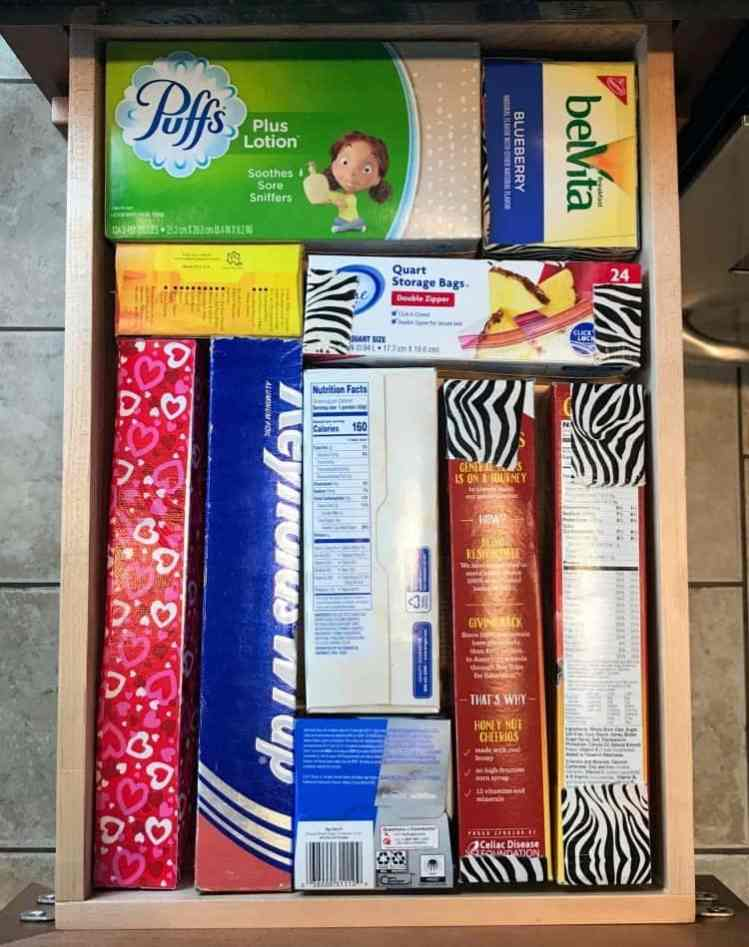 How to organize a junk drawer using different sized boxes