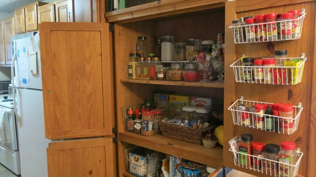 Make a pantry out of an entertainment center bins and shelves inside entertainment center