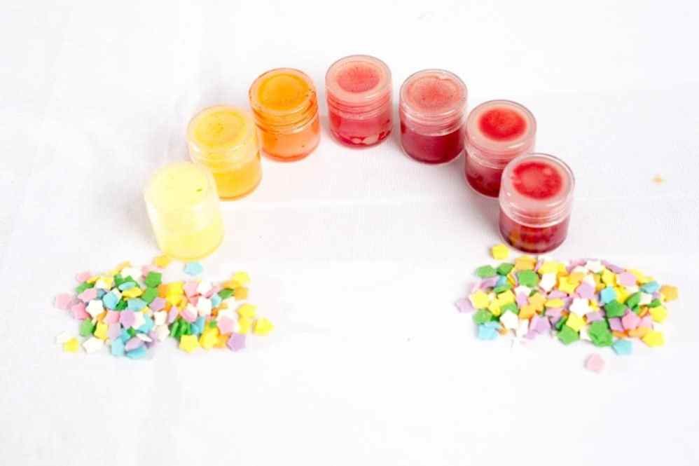 lip glosses of different colors in the shape of a rainbow