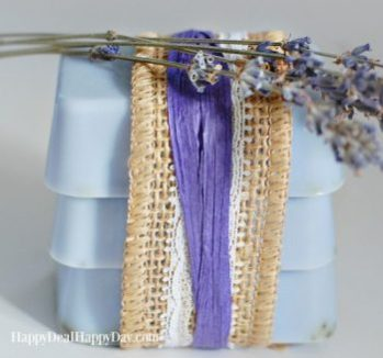 Three blue goats milk soap bars with  a lavender sprig