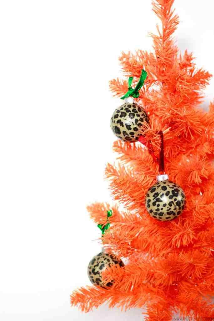 DIY Leopard print ball Christmas ornaments on an orange tree.