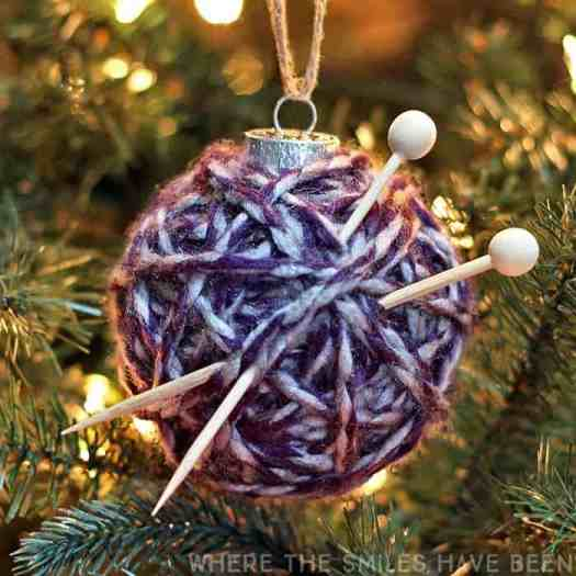 A yarn wrapped ornament with wooden skewers to make a yarn ball ornament DIY