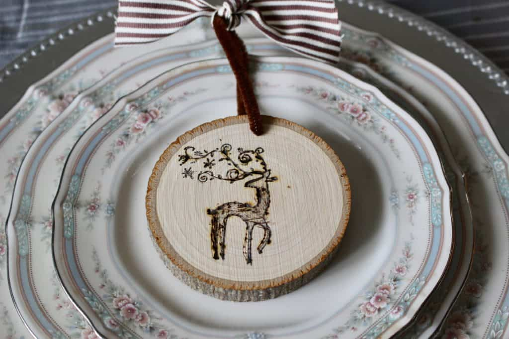 A reindeer wood burned on to a wood slice as a DIY ornament