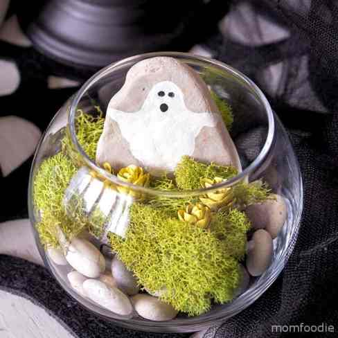 A DIY Halloween terrarium with a rock ghost