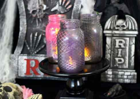 Halloween mason jars painted with a fish net pattern