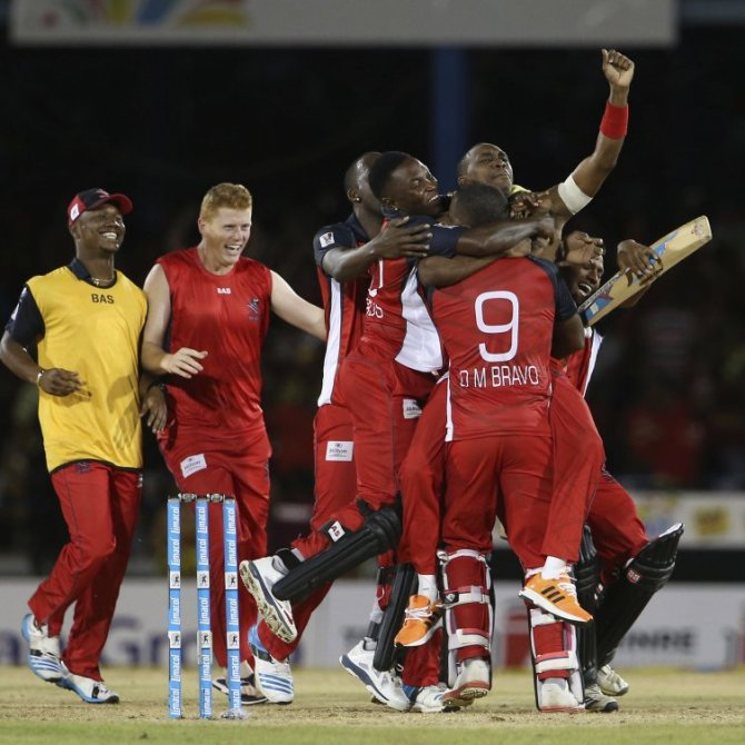 Bravo is mobbed by his teammates after hitting the last ball for six