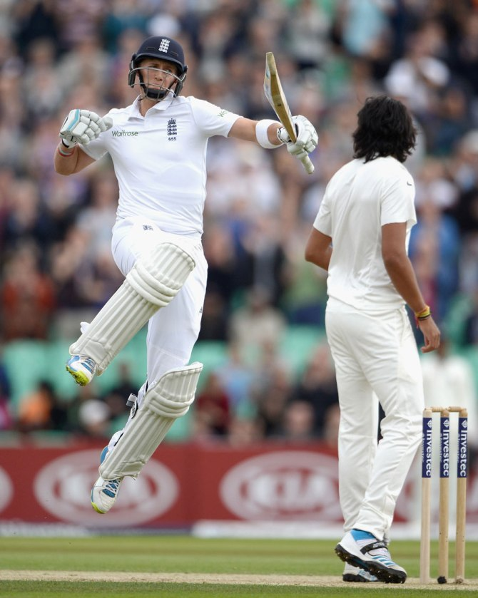 Root punches the air after bringing up his fifth Test century