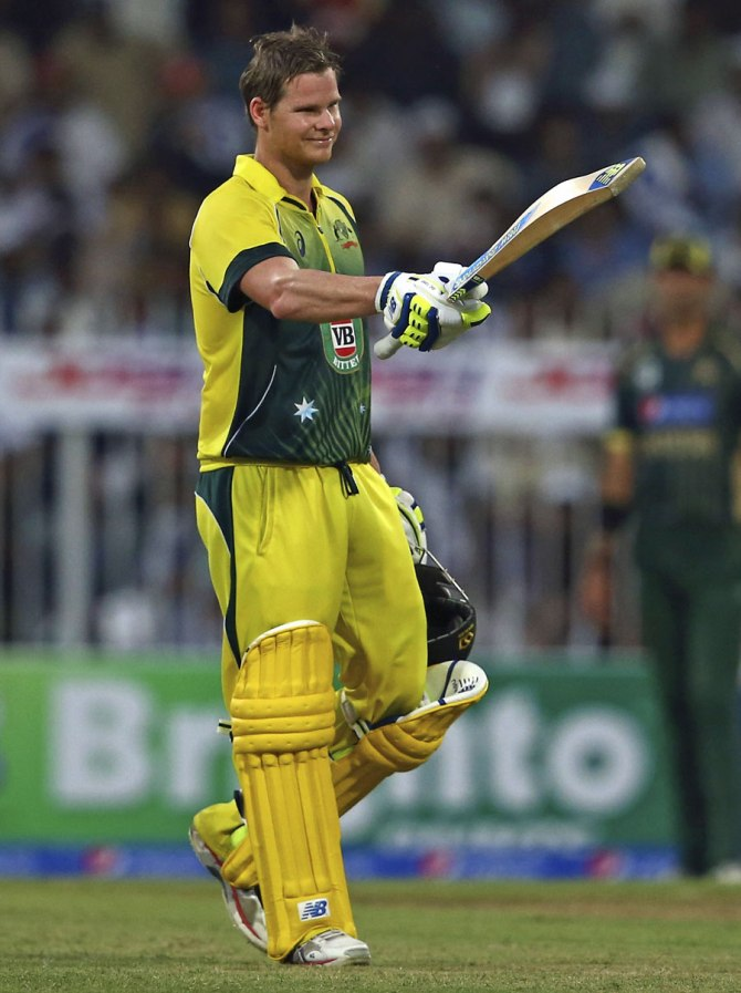 Smith celebrates after bringing up his maiden ODI century