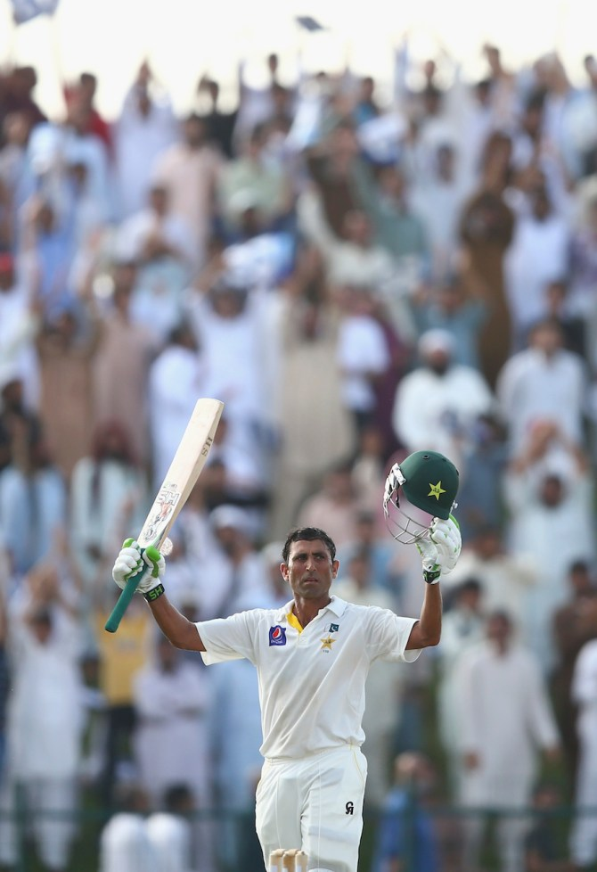 Khan celebrates after scoring his fifth double century