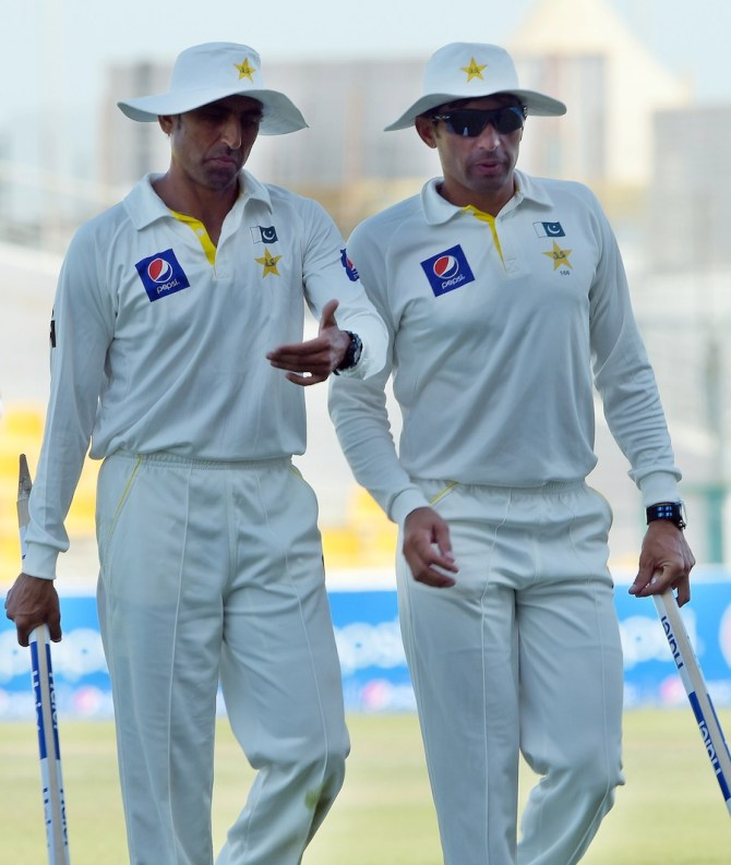 Ul-Haq and Younis Khan walk off after Pakistan won the match by 248 runs