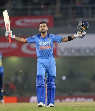 Kohli celebrates after scoring his 21st ODI century