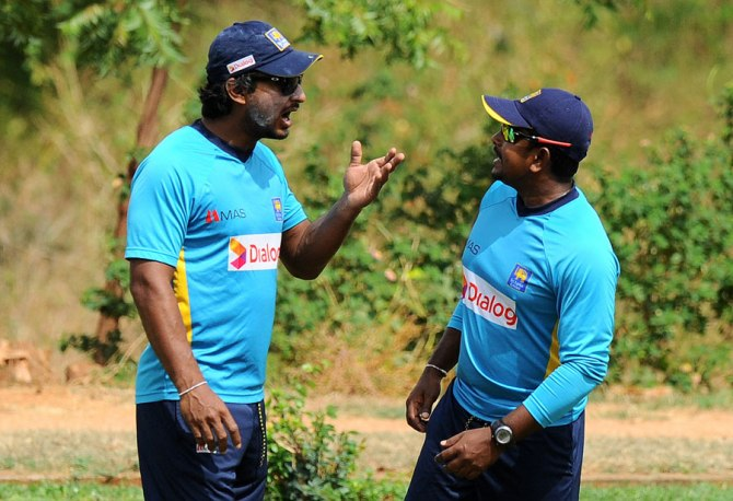 Herath (right) has taken seven wickets at an average of 25 in the series
