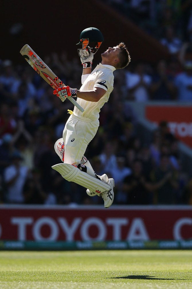 Warner leaps in the air after scoring his 11th Test century