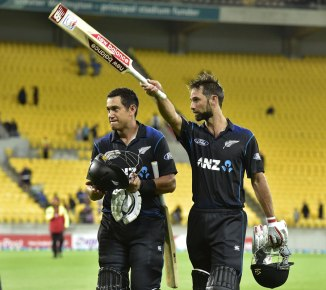 Elliott (right) was named Man of the Match for excelling with both the bat and ball