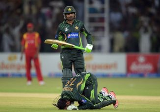 Malik celebrates after scoring his eighth ODI century