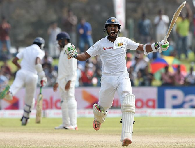 Chandimal celebrates after scoring his fourth Test century