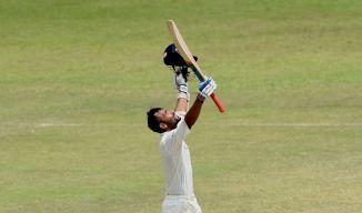 Rahane celebrates after scoring his fourth Test century