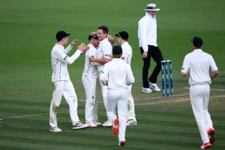 New Zealand took three quick wickets before the rain came