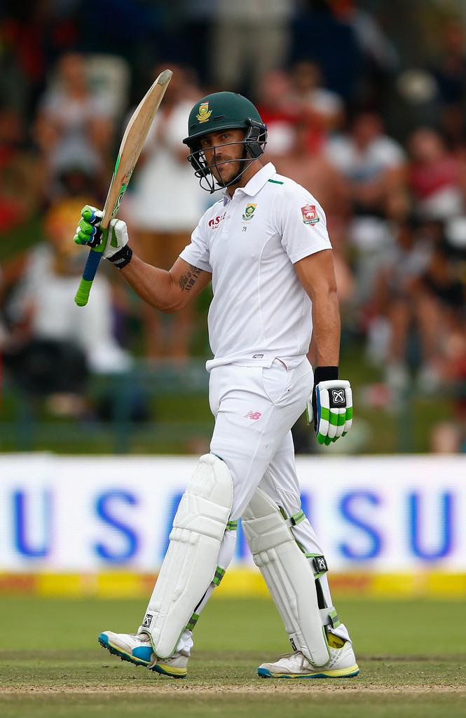 Du Plessis raises his bat after bringing up his half-century