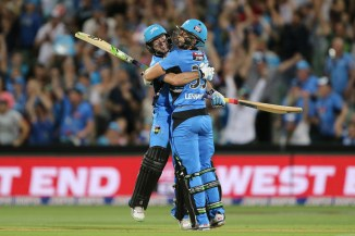 Lehmann (right) celebrates with Ludeman (left) after his last ball six