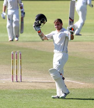 Latham celebrates after scoring his fourth Test century