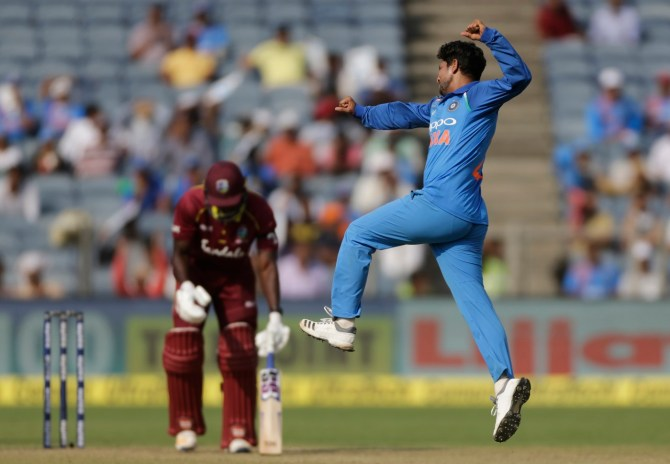 Kuldeep Yadav three wickets India West Indies 1st T20 Kolkata cricket