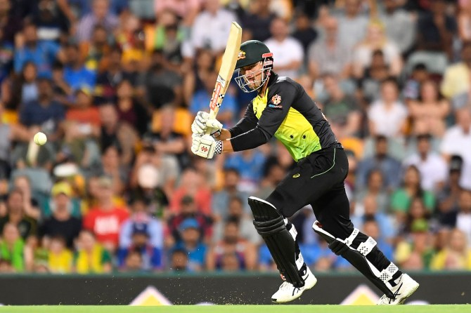 Marcus Stoinis 33 not out two wickets Australia India 1st T20 Brisbane cricket