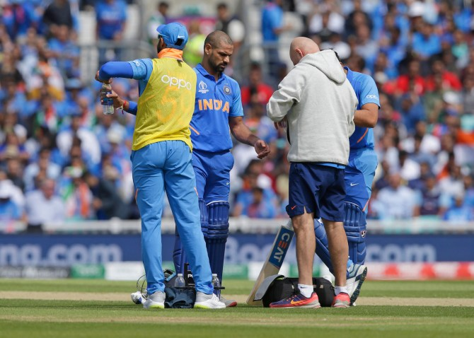 Shikhar Dhawan will stay with the India team for the time being despite suffering hairline fracture to his left thumb World Cup cricket