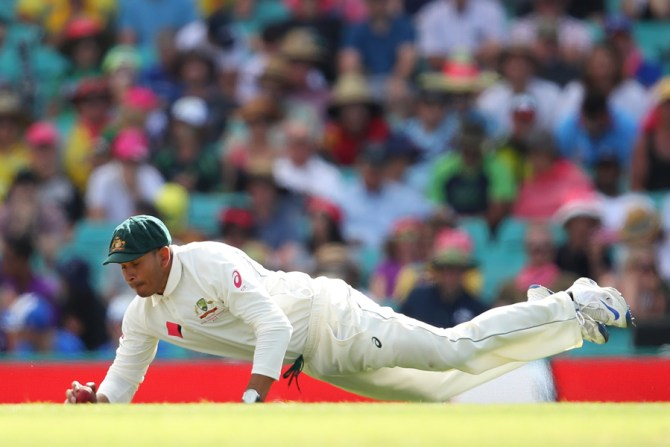 Pakistan-born Australia batsman Usman Khawaja took an unreal one-handed rebound catch at slip