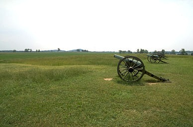 View of Confederate gun-line at the Southern end of Seminary Ridge. The Little and Big Round Top's can be seen in the distance. (Copyright Allen Goodall 2003)