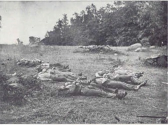 Some of the Confederate dead gathered for burial on the second day. (Library of Congress)